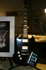 "Design mock-up of the ""Ax-Cellerate,"" guitar with built-in touch screen."